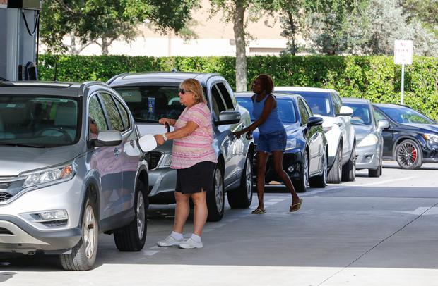 Customers line up for fuel at a Costco store ahead of the arrival of Hurricane Dorian in Pompano Beach, Florida, U.S. August 30, 2019. REUTERS/Joe Skipper