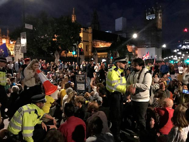 Police talking to protesters outside the Houses of Parliament, London, as demonstrations continue against Prime Minister Boris Johnson temporarily closing down the Commons from the second week of September until October 14 when there will be a Queen's Speech to open a new session of Parliament. Jess Glass/PA Wire