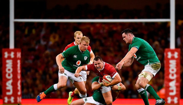 Ryan Elias of Wales is tackled by Dave Kilcoyne of Ireland