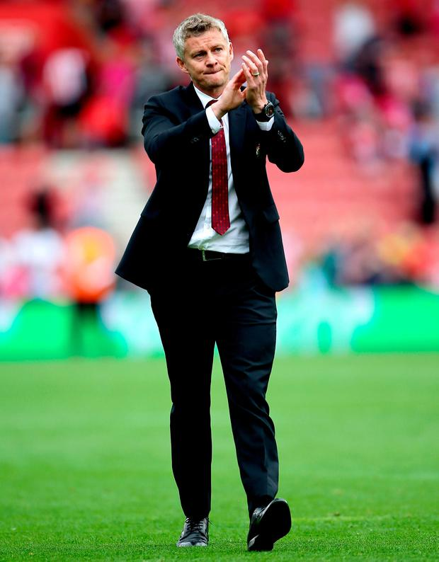 Manchester United manager Ole Gunnar Solskjaer applauds the fans