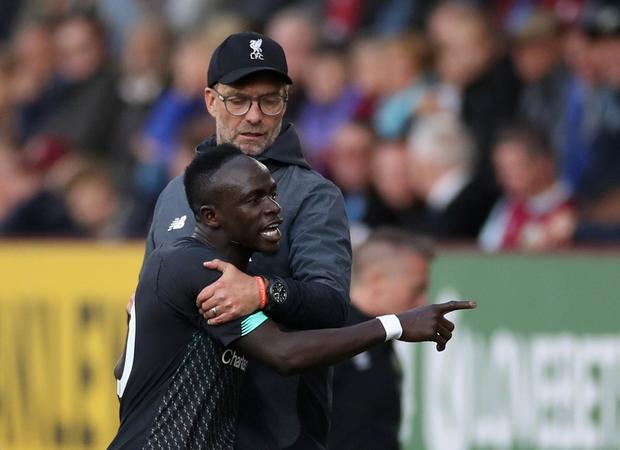 Liverpool's Sadio Mane reacts after being substituted off as manager Jurgen Klopp looks on