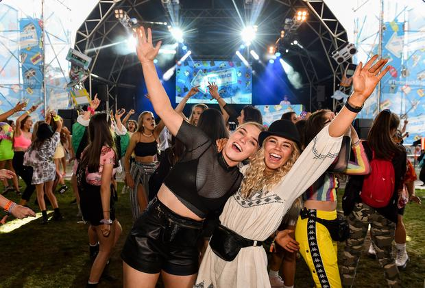 Jessie Morrissey, left, and Clare O'Gorman from Enniscorthy, Co Wexford, at the Throwback Stage during day one of Electric Picnic. Photo: Brian McEvoy and Sam Barnes