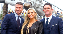 David Beckham alongside Claudine and Robbie Keane