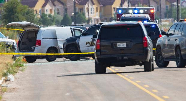 Odessa and Midland police and sheriff's deputies surround a white van in Odessa, Texas, Saturday, Aug. 31, 2019, after reports of gunfire. (Tim Fischer/Midland Reporter-Telegram via AP)