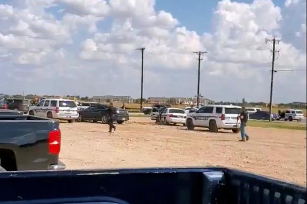 Police arrive at Cinergy Odessa cinema following a shooting in Odessa, Texas, U.S. in this still image taken from a social media video August 31, 2019. Mario A Leal via REUTERS