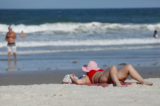 A woman sunbathes ahead of the arrival of Hurricane Dorian in Daytona Beach, Florida, U.S. August 31, 2019. REUTERS/Marco Bello