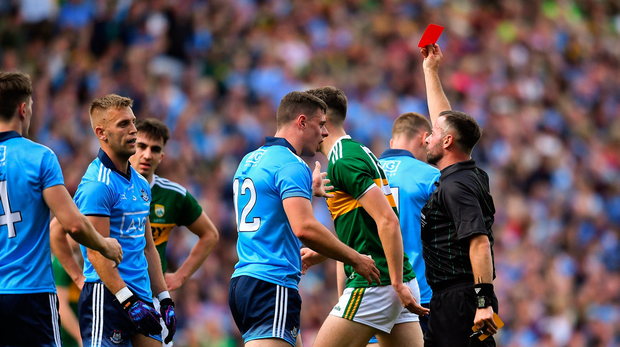 Jonny Cooper of Dublin, second from left, is shown the red card by referee David Gough
