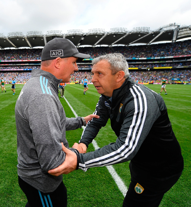Dublin manager Jim Gavin, right, and Kerry manager Peter Keane shake hands after the draw