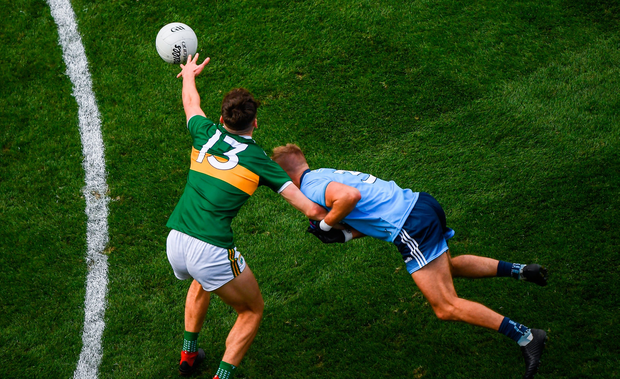 David Clifford of Kerry is fouled by Jonny Cooper of Dublin, resulting a red card