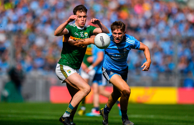 Michael Fitzsimons of Dublin in action against Jack Barry of Kerry