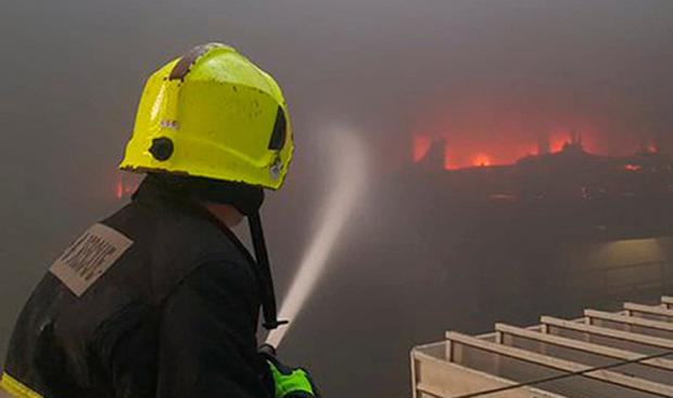 A firefighter tackles the blaze Cork City Fire Brigade/PA Wire