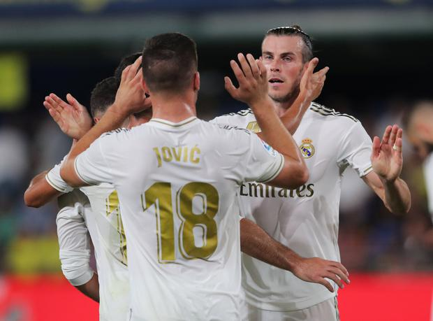 Real Madrid's Gareth Bale celebrates scoring their first goal with Luka Jovic and team-mates