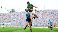 Red card: Dublin's Jonny Cooper grapples with Kerry's David Clifford. Cooper was sent off in the first half, but Kerry failed to capitalise on the advantage. Photo: David Fitzgerald/Sportsfile