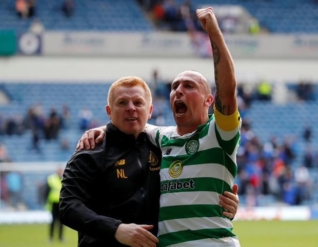 Celtic manager Neil Lennon and Celtic's Scott Brown celebrate after the match. Photo: Russell Cheyne/Reuters