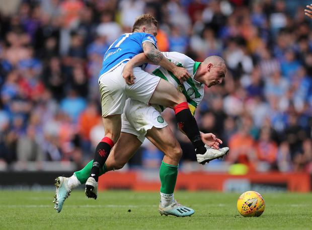 Celtic's Scott Brown in action with Rangers' Scott Arfield. Photo: Lee Smith/Action Images via Reuters