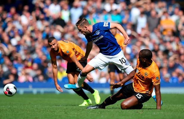 Gylfi Sigurdsson of Everton battles with Willy Boly of Wolverhampton Wanderers. Photo: Jan Kruger/Getty Images