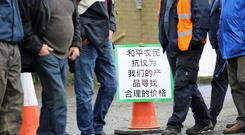 "A sign in chinese on the farmers protest outside Liffey Meats in Ballyjamesduff, Co. Cavan which was left there for potential Chinese investors to read. It translates as ""peaceful farmers protest, looking for a fair price for our product"". Photo: Lorraine Teevan"