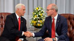 Tanaiste Simon Coveney (right) at a meeting with US Vice President Mike Pence Photo credit: Jacob King/PA Wire