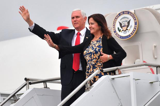 Return to roots: Mike Pence and wife Karen arrive at Shannon Airport. Photo: Jacob King/PA Wire
