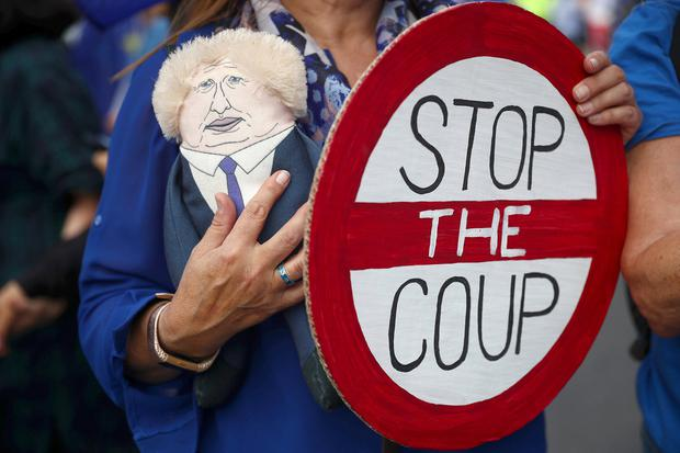 An anti-Brexit protester holds a puppet and a sign during a demonstration at Westminster, in London, Britain September 3, 2019. REUTERS/Hannah McKay