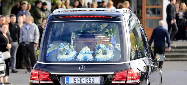The remains of Vincent Parsons arrive at The Church of the Transfiguration in Oldbawn for his funeral mass. Picture; Gerry Mooney