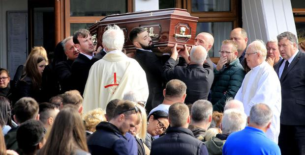 The remains of Vincent Parsons are taken from The Church of the Transfiguration in Oldbawn following his funeral mass. Picture; Gerry Mooney