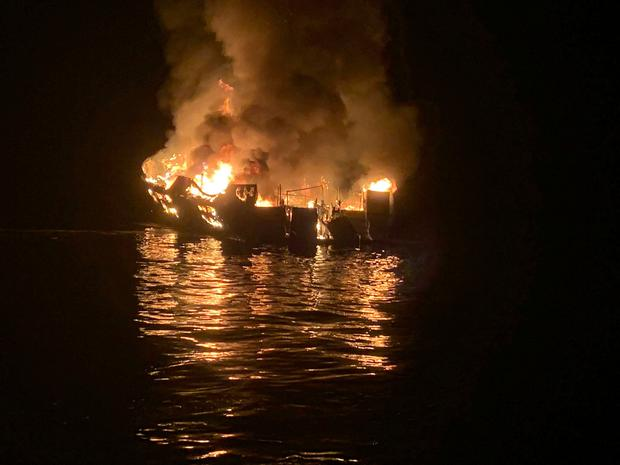 In this photo provided by the Santa Barbara County Fire Department, a dive boat is engulfed in flames after a deadly fire broke out aboard the commercial scuba diving vessel off the Southern California Coast, Monday morning, Sept. 2, 2019. (Santa Barbara County Fire Department via AP)