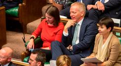 Former Conservative MP Phillip Lee (C) sitting next to Leader of the Liberal Democrats Jo Swinson. Photo: AFP/Getty Images