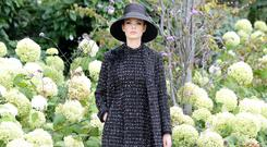 Tweed success: Louise Kennedy 'Gabriella' coat in lurex tweed (€1,495) with 'Cassandra' corsage (€195); 'Lara' floor-length tweed dress, (€1,495). Straw bucket hat by Anthony Peto. Photo: SASKO LAKAROV