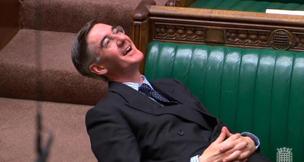 Leader of the House of Commons Jacob Rees-Mogg reclining on his seat in the House of Commons London. PA Wire