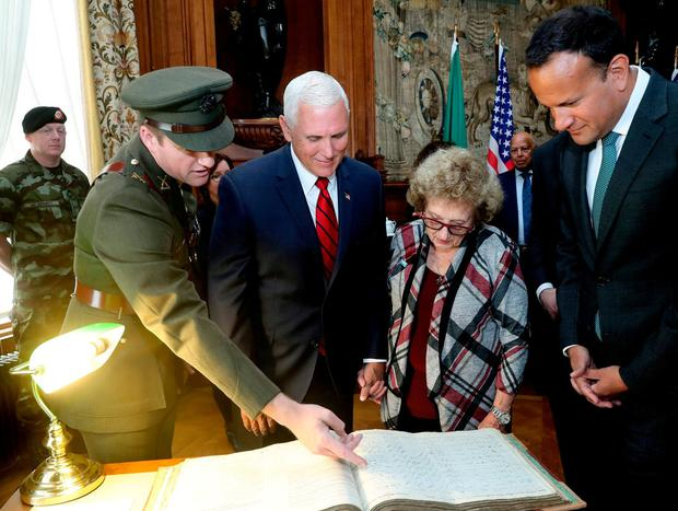 Family history: Mike Pence and his mother Nancy Pence-Fritsch are shown her father's record in the Defence Forces during the Civil War. Photo: PA