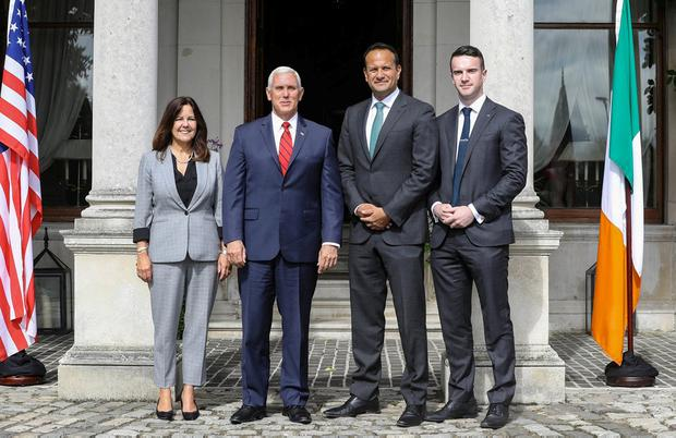 Smile for the cameras: Mike Pence and his wife Karen meet Leo Varadkar and his partner Matt Barrett. Photo: REUTERS