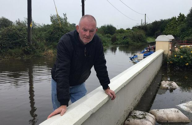Flooded out: Pat Cronin stands in front of his home in Coonagh, which was destroyed by the waters. Photo: David Raleigh