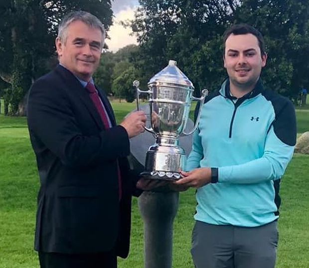 Racking up the wins: Carlow Golf Club's vice-captain, John Brophy, presents the Midland Scratch Trophy to Nenagh's David Reddan Junior