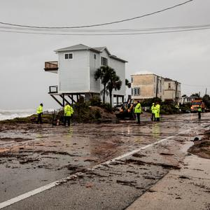 Florida Department of Transportation members work on the A1A closed coastal route of Vilano Beach due to debris and flooding from Hurricane Dorian, in St. Augustine, Florida, U.S., September 4, 2019. REUTERS/Maria Alejandra Cardona