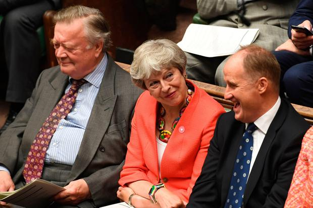 Cheerful: Theresa May and Kenneth Clarke (left) enjoy Prime Minister Boris Johnson's first Prime Minister's Questions in the House of Commons yesterday. Photo: AFP/Getty Images