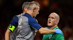 A world of pain: Devin Toner - pictured with Ireland team doctor Dr Ciaran Cosgrave during the Wales match - will be hurting this week. Photo: Brendan Moran/Sportsfile