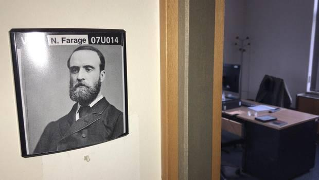 Big idol: Parnell's portrait beneath Farage's name on the wall of his Brussels office