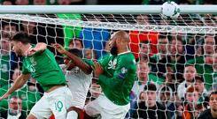On target: David McGoldrick rises highest to level in last night's clash against Switzerland. Photo: Catherine Ivill/Getty Images