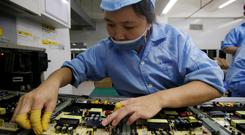 An employee works on the production line of a television factory under Zhaochi Group in Shenzhen, China August 8, 2019. Picture taken August 8, 2019. REUTERS/Jason Lee