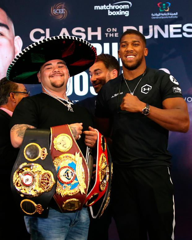 Andy Ruiz, Eddie Hearn and Anthony Joshua during a press conference at The Hilton London Syon Park, London. Steven Paston/PA Wire