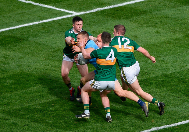 Con O'Callaghan is tackled by the Kerry trio of Paul Murphy, Tom O'Sullivan (4) and Stephen O'Brien during last Sunday's drawn final. Photo: Daire Brennan/Sportsfile