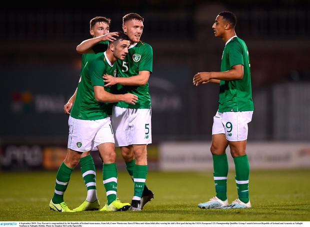 Troy Parrott is congratulated by his Republic of Ireland team-mates, from left, Conor Masterson, Dara O'Shea and Adam Idah after scoring his side's first goal during the UEFA European U21 Championship Qualifier Group 1 match between Republic of Ireland and Armenia at Tallaght Stadium in Tallaght, Dublin. Photo by Stephen McCarthy/Sportsfile