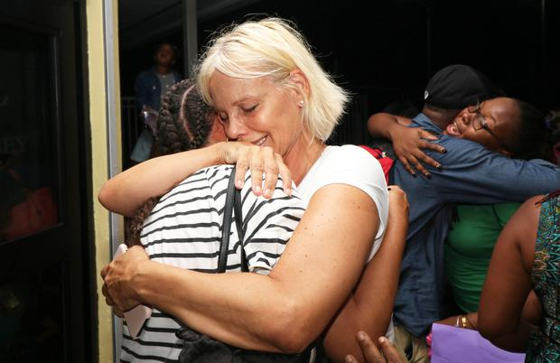 Reunited: Families embrace after survivors were evacuated from the Abaco Islands to Nassau. Photo: Reuters