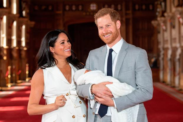 Happy family: Harry and Meghan with their baby son Archie shortly after his birth. Photo: Dominic Lipinski/PA Wire