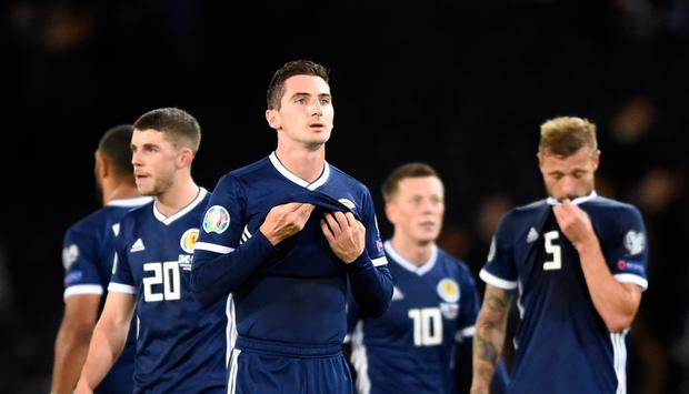 Scotland's Kenny McLean (centre) appears dejected after the final whistle of the UEFA Euro 2020 Qualifying, Group I match at Hampden Park, Glasgow. PA Photo.