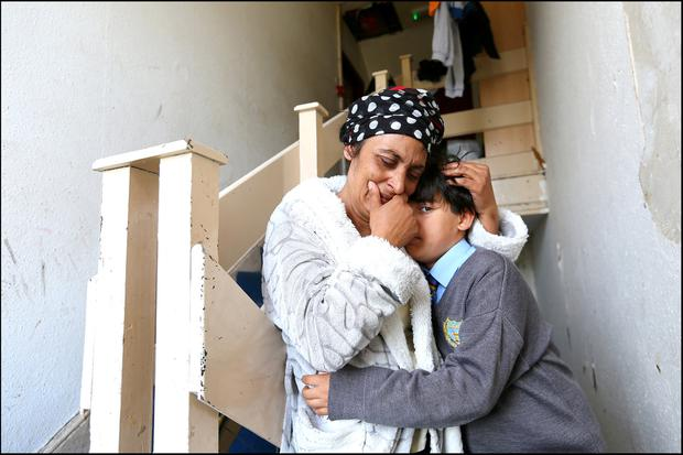 Linonice Serban, from Romania, and her son Ionut (9), who have been ordered to leave their flat. Picture: David Conachy