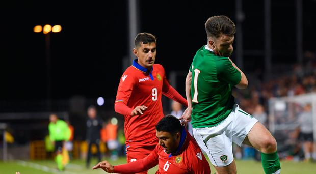 Aaron Connolly skips away from the Armenian defence. Photo: Sportsfile