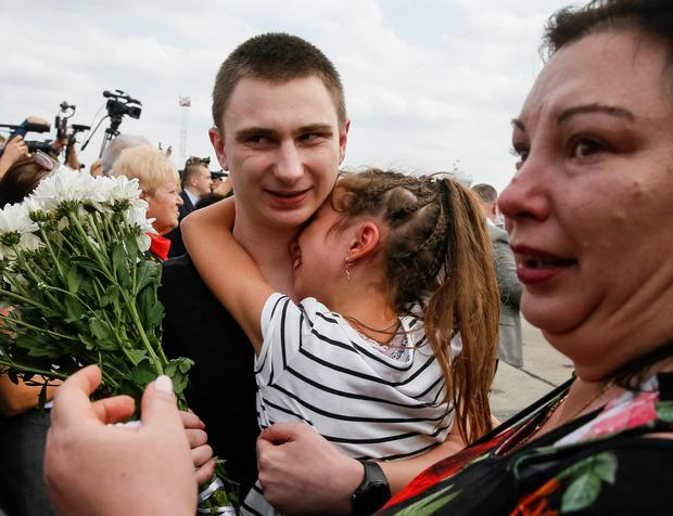 Vyacheslav Zinchenko, a crew member of Ukrainian naval ships, which were seized by Russia's FSB security service in 2018, is greeted by his relatives upon arrival in Kiev after Russia-Ukraine prisoner swap, at Borispil International Airport, outside Kiev, Ukraine September 7, 2019. REUTERS/Gleb Garanich