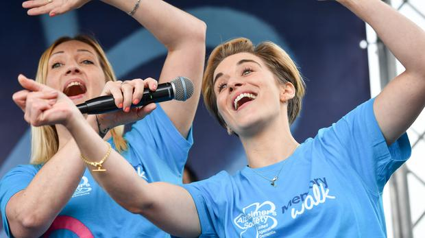 Line of Duty star Vicky McClure (right) on stage at the Alzheimer's Society's Nottingham Memory Walk alongside members of the BBC's Our Dementia Choir (Jacob King/PA)